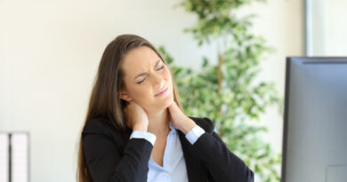 working woman with neck pain